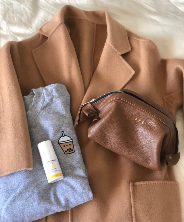 Reclaim coat with Too Funni sweatshirt, Apothekari Skincare and Atelier Ali